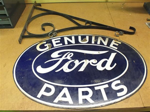 ford genuine parts double sided porcelain marked property of ford motor co with original sign bracket